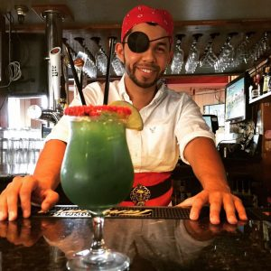 pirate bartender serving green drink